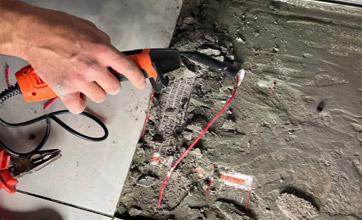 electrician repairing underfloor heating